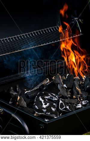 Barbecue Grill Pit With Glowing And Flaming Hot Open Fire With Red Flame, Hot Charcoal Briquettes An