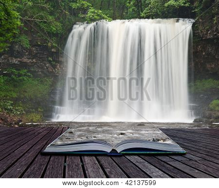 Creative composite image of waterfall in woods in pages of magic book poster