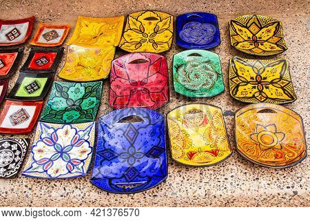 Colorful Ceramic Plates For Sale. Typical Traditional Moroccan Ceramic Plates In A Gift Store. Moroc