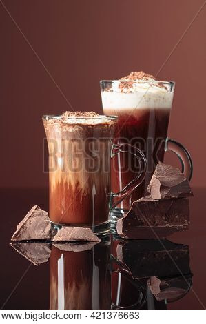Hot Chocolate With Whipped Cream And Pieces Of Dark Chocolate On A Dark Brown Background.