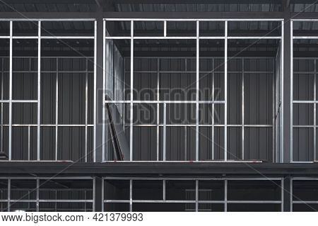 Front View Of Steel Wall Structure And Metal Sheet Roof Of Various Rooms On The Upper Floors Of 2-st