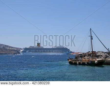 Cruise Ships In Greece Sailing In The Caldera Of The Island Of Santorini. In The Background The Blue