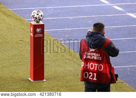 Kyiv, Ukraine - March 28, 2021: Photographer Takes A Picture Of The Official Match Ball Of The Fifa