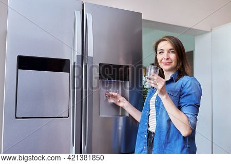 Water Dispenser, Woman Taking Cold Water Into Glass From Home Refrigerator