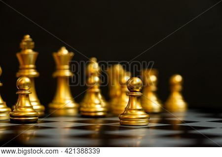 Gold Pawn Is On The First Move In Chess Game On Black Background (concept For Business Decision, Sta