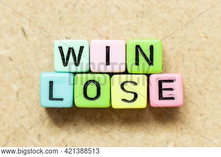 Color Alphabet Letter Block In Word Win Lose On Wood Background