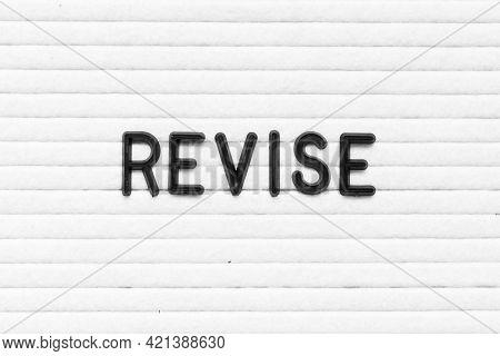 Black Color Letter In Word Revise On White Felt Board Background