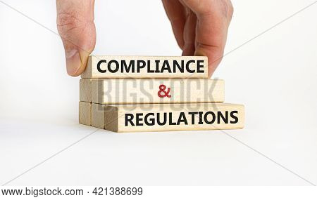 Compliance And Regulations Symbol. Concept Words 'compliance And Regulations' On Wooden Blocks, Beau