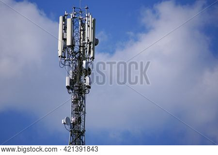 Communication Tower 3g Or 4g Network Telephone Cellsite Silhouette On Blue Sky. Implementation Of Co