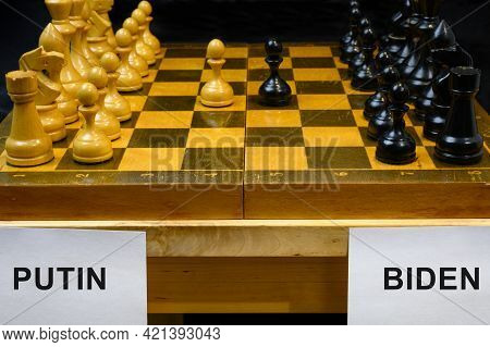 Russia Vs Usa, Chess Like Geopolitics Game. The Names Putin And Biden By Chessboard. Concept Of Summ