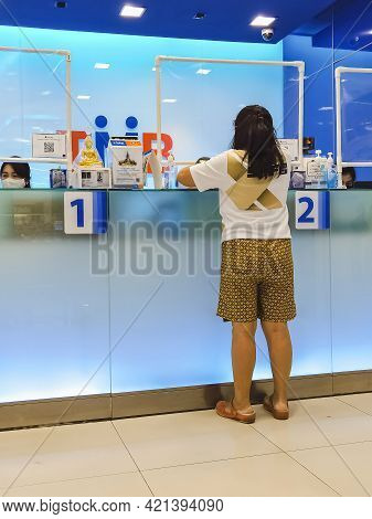 Kanchanaburi, Thailand - August 27, 2020 : Unidentified Asian Female Customer  Transact With Bank St