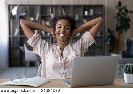 Happy Millennial African Ethnicity Woman Resting After Hardworking Day.