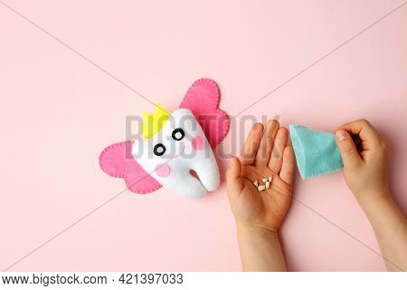 Felt Tooth Fairy Pillow In Kids Hands On Pink Background With Copy Space For Text. Handmade Children