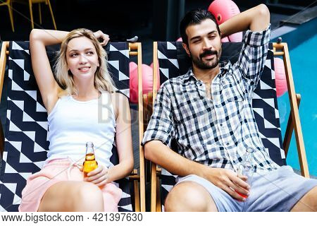 Happy Friends Or Couple With Drinks At Outdoors Or Hotel Or Resort Young Couple Celebrating Honeymoo