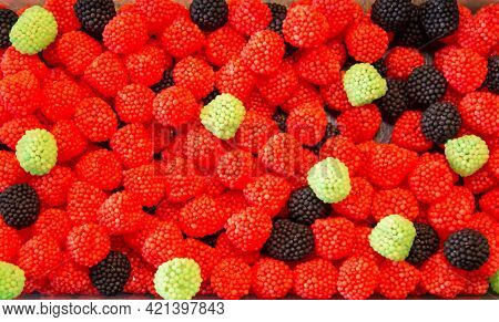 Round-shaped Marmalade Candies Rolled Into Crumbs Of Various Colors In A Pile. Confectionery Product