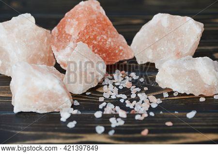Himalayan Salt Chunks Lie On Wooden Background
