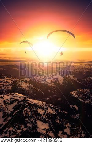 Adventure Composite Image Of Paraglider Flying Up High In The Rocky Mountains. Sunny Sunset Sky. Aer