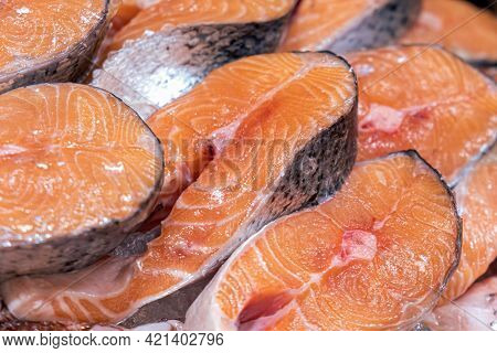 Fresh Fish Counter In The Market. Laid Out On Ice Salmon Steaks. Natural Products, Proper Nutrition,