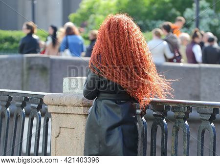 Red-haired Girl At The Cast-iron Embankment Fence, Griboyedov Canal Embankment, Saint Petersburg, Ru