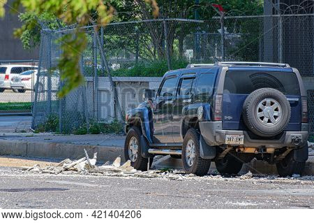 New Orleans, La - May 22: Parked Car And Fallen Debris From Abandoned Plaza Tower Building In Centra