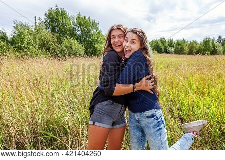 Summer Holidays Vacation Happy People Concept. Group Of Two Girl Friends Sisters Dancing Hugging And