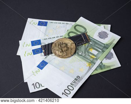 On A Black Background Are Euro Banknotes, An M2 Ssd Disk And Bitcoin. The Concept Of Mining On Hard
