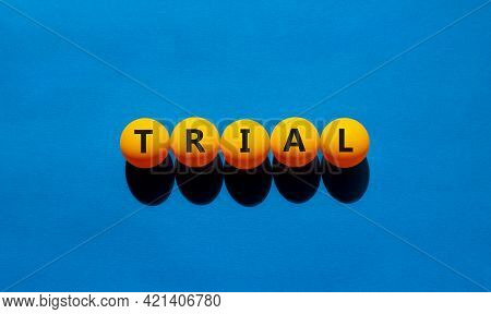 Trial Symbol. Orange Table Tennis Balls With The Words 'trial'. Beautiful Blue Background, Copy Spac