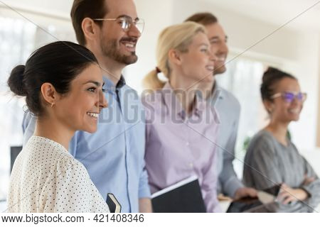 Close Up Happy Diverse Motivated Employees Team Standing In Office