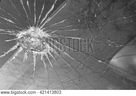 Broken Windshield Of A Car, Web Of Splits On The Triplex Windscreen. The Consequences Of Hitting The