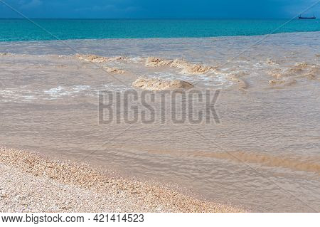 Muddy River Water Mixed With Blue Seawater And An Empty Beach Coast. Summer Seascape, Crimea