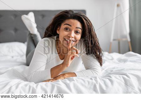 Black Lady Puting Finger On Lips, Making Hush Sign