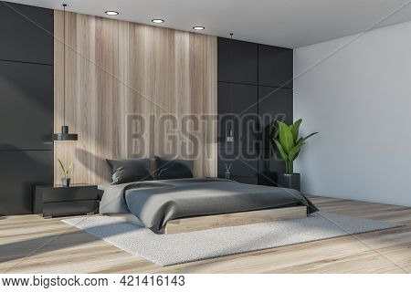 Dark Bedroom Interior With Bed And Pillows, Parquet Floor And Plant. Mockup Copy Space In Minimalist