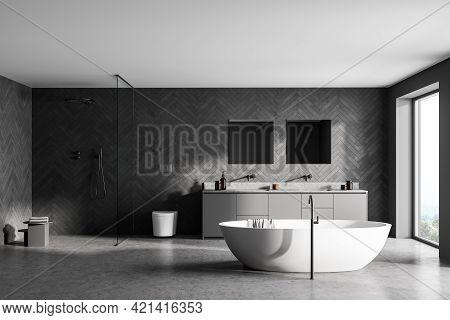 Spacious Modern Bathroom Design Interior In Gray Tones With Concrete Floor, Freestanding Tub, Walk-i