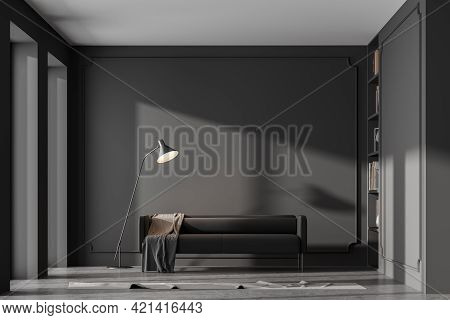 Modern Home Interior With Dark Grey Couch Concrete Floor, Panoramic Windows. Empty Mock Up Gray Wall