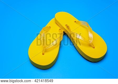 Yellow Flip Flops On A Blue Background