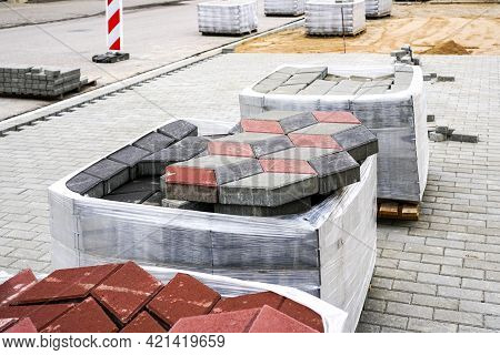 Paving With Paving Slabs Of Different Colors, View Of The Construction Site With Materials