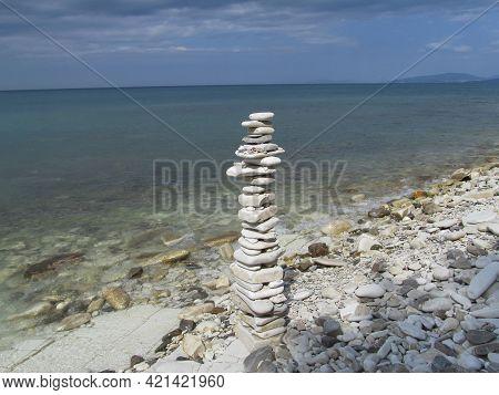 Loveliness Tower Of Stones On The Seashore