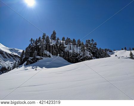 Beautiful Winter Landscape In The Mountains Above Davsos Klosters At The Fluela Pass. Ski Tour On Th