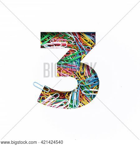 Number Three Of Colorful Rainbow Paperclips, White Cut Paper Sheet. Third Numeral. Typeface. Office