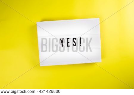 Lightbox With Message Yes Isolated On Yellow Background. Concept Of Positive Decision, Answer, Choic