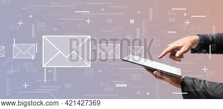 Mailing Concept With Digital Tablet In Man Hands On Abstract Bacground With White Envelopes