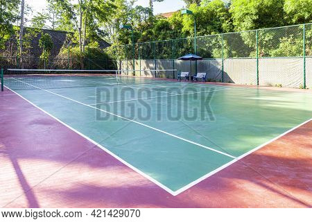New Concrete Tennis Courts Available. With The Morning Sun