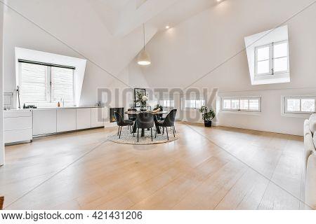Minimalist Style Interior Design Of Spacious Attic Loft Apartment With White Walls And Parquet Floor