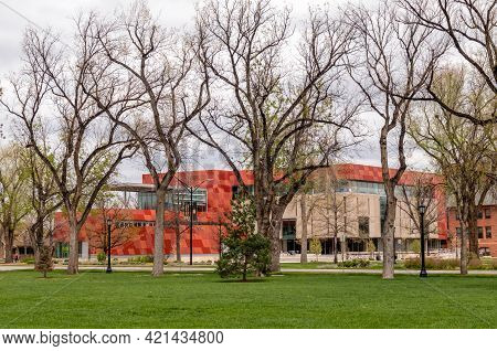 Colorado Springs, Colorado - May 15, 2021: Urban Park With The Trees And The Distant View Of Tutt Li