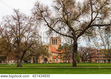 Urban Park With The Trees And The Distant View Of The Historic Shove Memorial Chapel In Colorado Spr