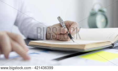 Head Of Accounting Is Recording The Company's Financial Growth Statistics Using Graphs As A Referenc