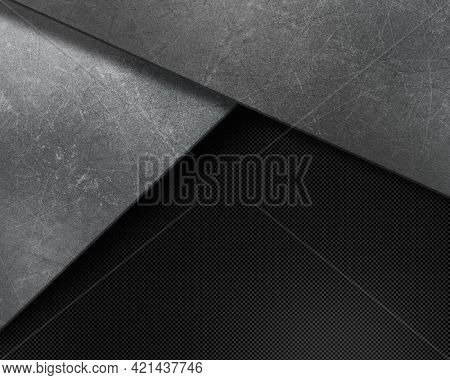 Abstract background with grunge scratched textures on carbon fibre