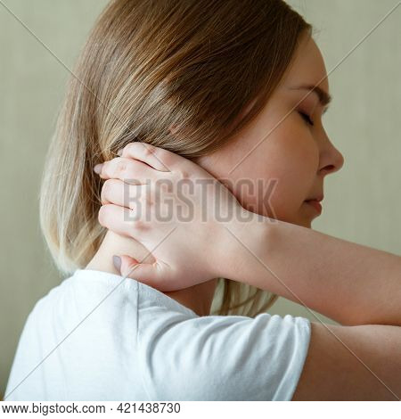 Woman Holds Neck With Pain Cervical Muscle Spasm By Hand. Neck Pain, Cervical Vertebrae, Disease Of