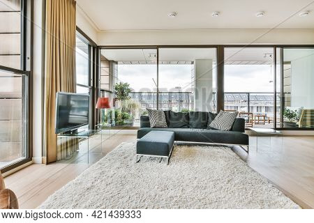 Modern Interior Design Of Contemporary Open Space Apartment With Comfortable Sofa And Soft Carpet In