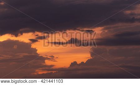 Beautiful Orange Sunset Sky With Layers Of Gray And Dark Clouds. Scenic View. Beauty In Nature. Twil